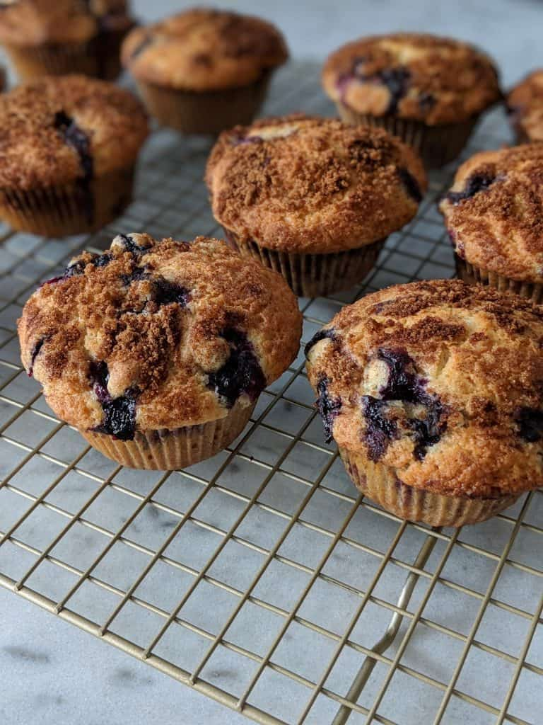 Blueberry muffins cooling on a rack