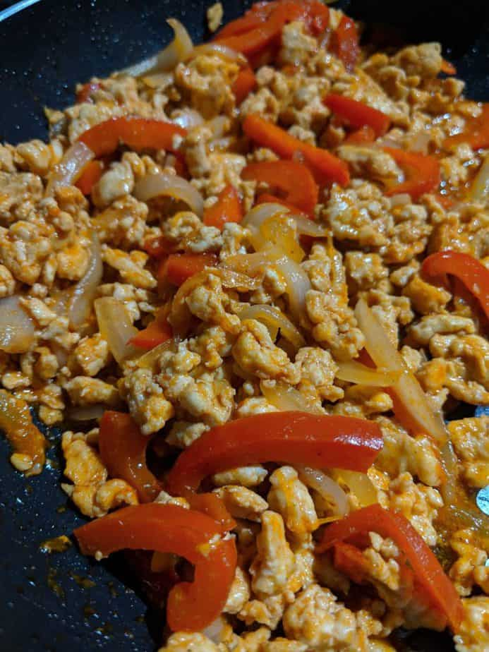 Ground chicken and vegetables in a skillet