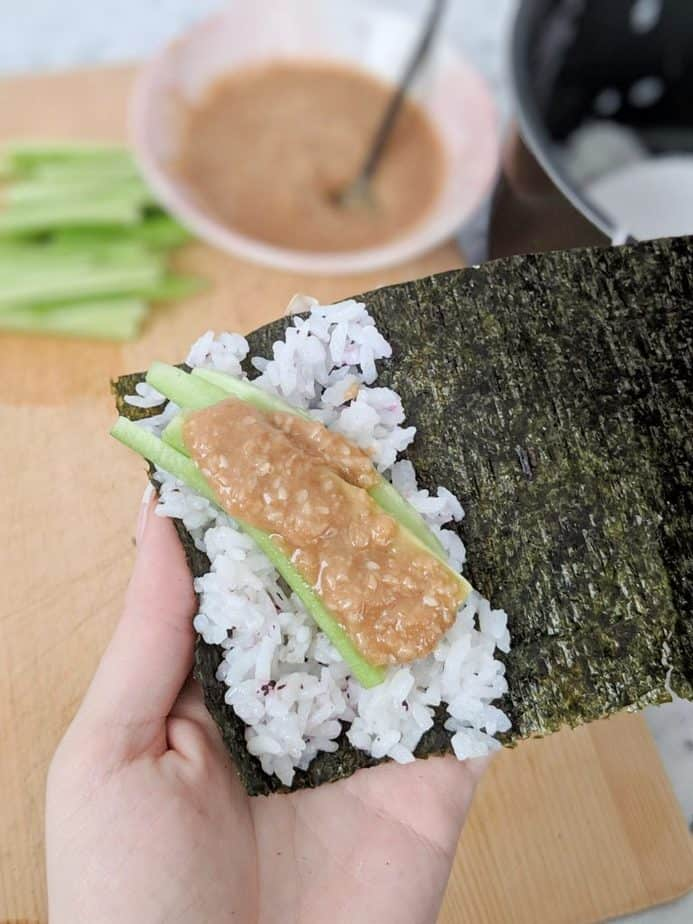 Cucumber, rice, and sesame sauce on nori