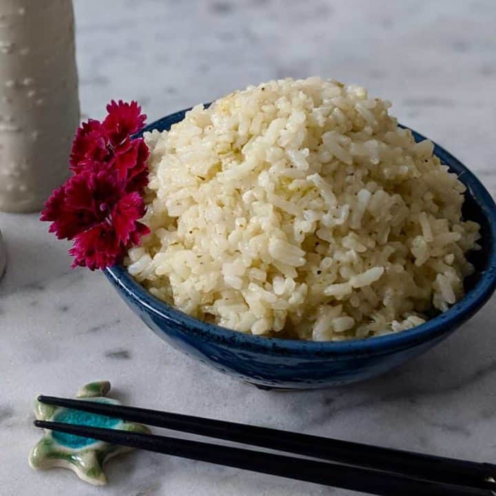 Japanese ceramics with coconut rice decorated by pink flowers