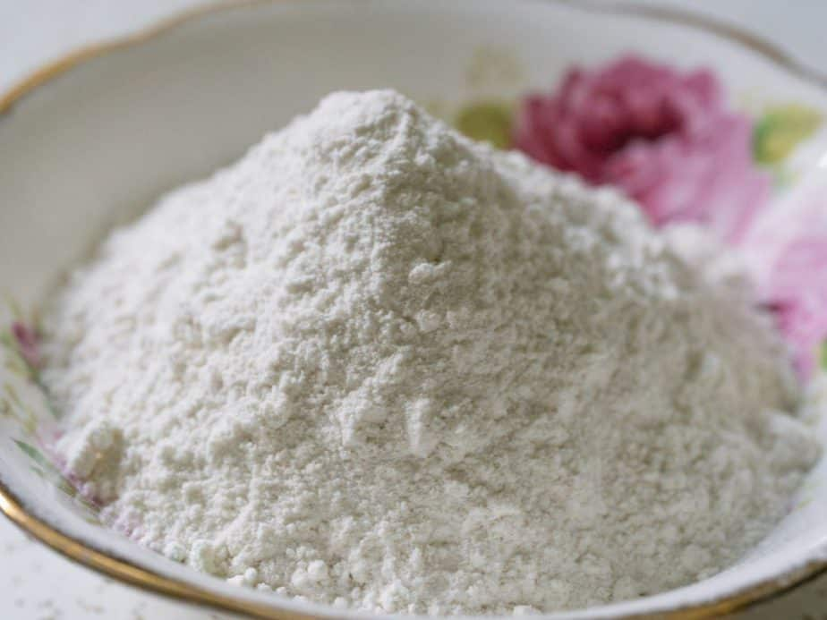 A bowl of white, dry ingredients.