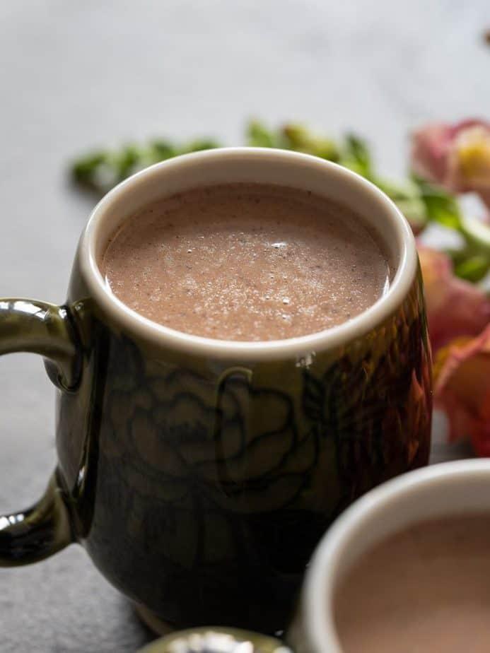 A close up of a mug of cocoa tea.