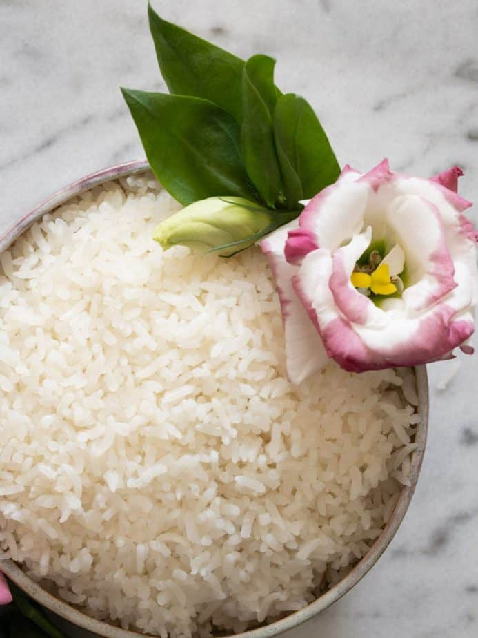 A close up overhead shot of a bowl of Thai coconut rice.