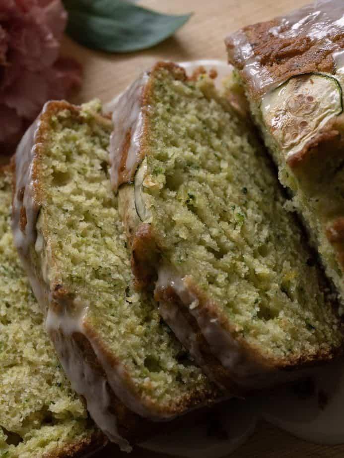 Sliced lemon zucchini bread showing the tenderness inside.