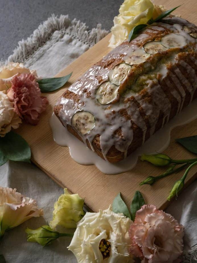 Overhead shot of lemon zucchini bread styled with flowers.